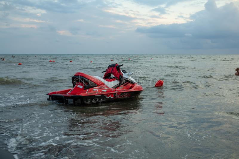 Ureki, Georgia August 2018 Black Sand Beach Red Hydrocycle. On the sea water at the bad weather before storm stock images