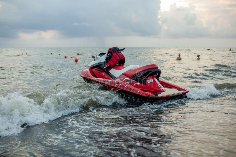 Ureki, Georgia August 2018 Black Sand Beach Red Hydrocycle. On the sea water at the bad weather before storm stock photo