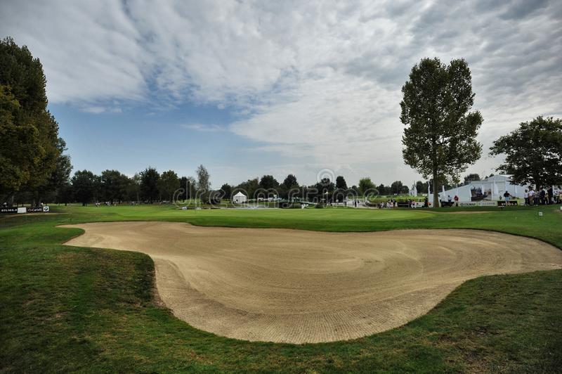 Urin Italy circa September empty golf course green and fairway panoramic view with bunker in foreground. Urin Italy circa September 2016 empty golf course green royalty free stock photos