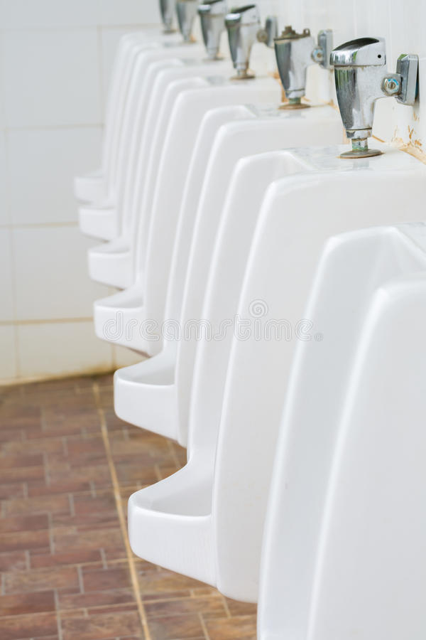 Urinals Men public toilet royalty free stock images