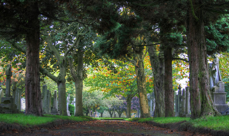 Urmston Cemetery. In early autumn, the trees are beginning to change colour in Urmston Cemetery, Manchester stock images
