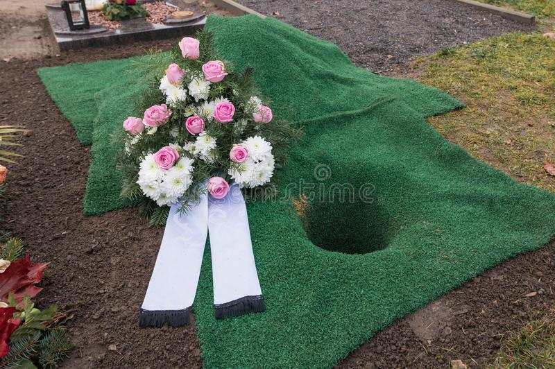 Urn grave with a wreath royalty free stock images