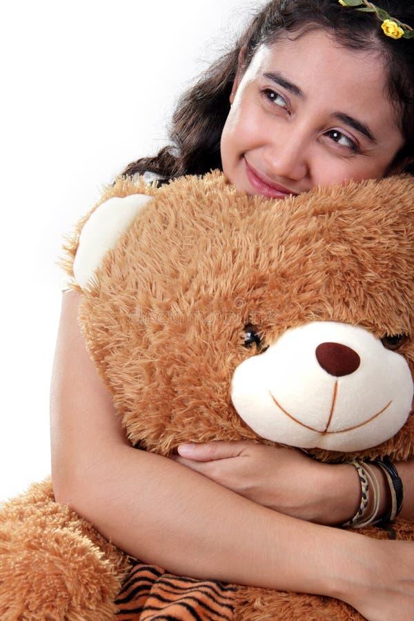 Urocza dziewczyna i jej miś pluszowy fotografia royalty free