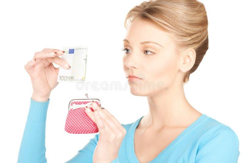 Urocza kobieta z kiesą i pieniądze zdjęcia stock