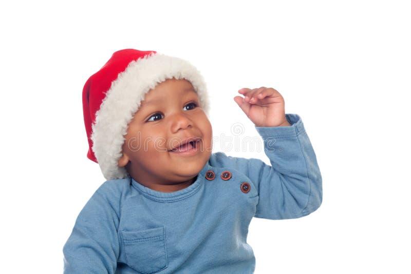 Uroczy afrykański dziecko z Bożenarodzeniowym kapeluszem zdjęcie stock