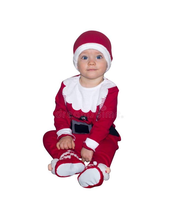 Uroczy dziecko w Święty Mikołaj ubraniach odizolowywających zdjęcie royalty free