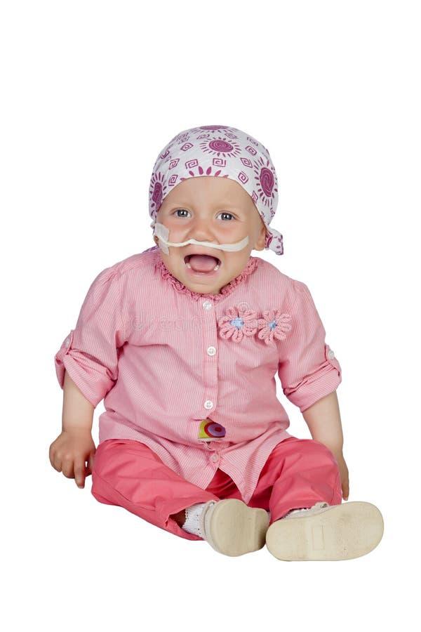 Uroczy dziecko z chustka na głowę bije chorobę zdjęcia stock