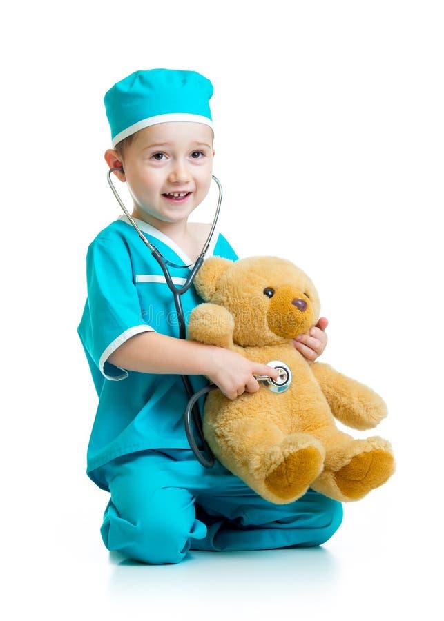Uroczy dziecko z ubraniami doktorski egzamininować zdjęcie royalty free
