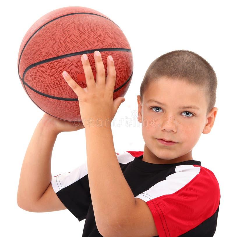 uroczy koszykówki chłopiec dziecka gracza mundur obrazy royalty free