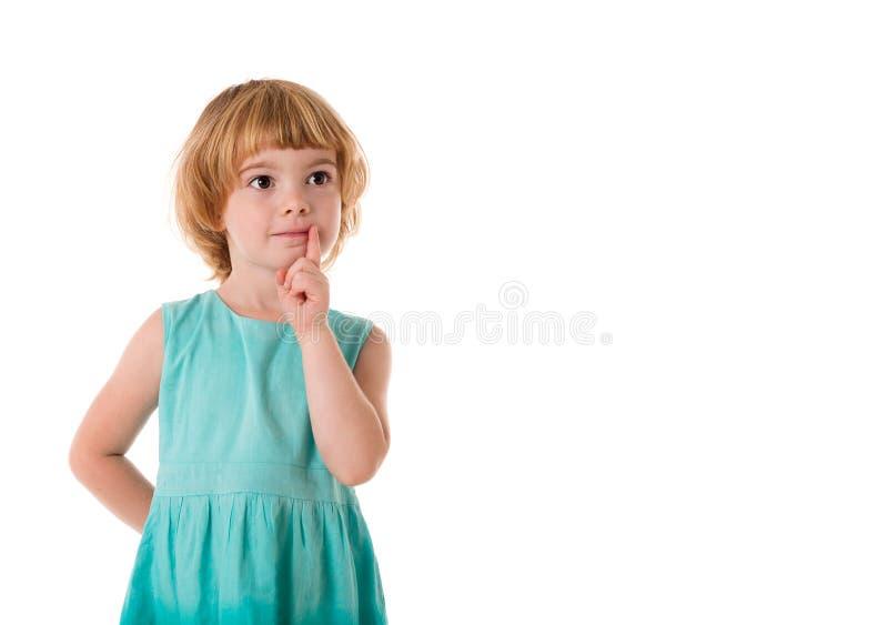 Uroczy mała dziewczynka portret patrzeje na boku fotografia royalty free
