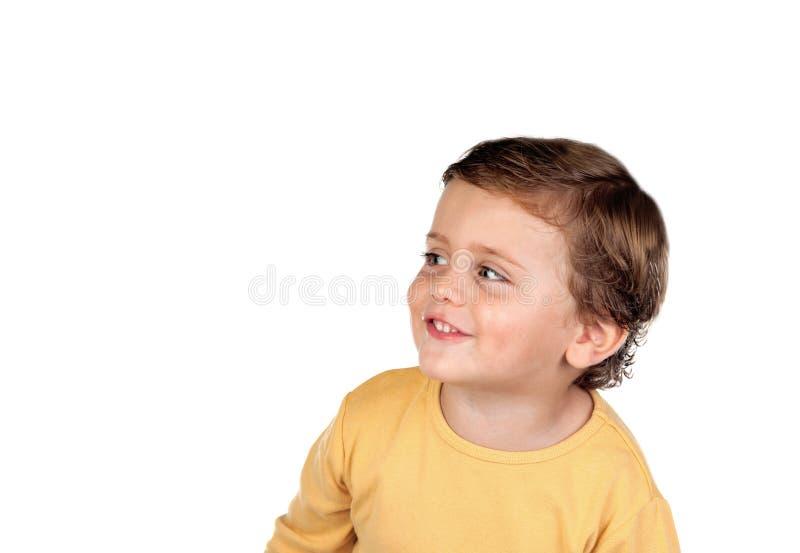 Uroczy mały dziecka dwa lat patrzeje stronę obrazy royalty free