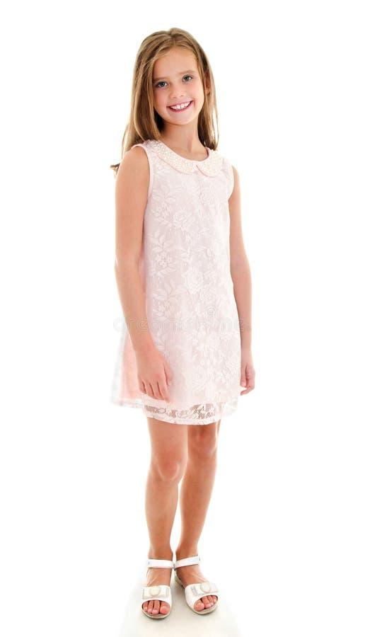 Uroczy uśmiechnięty małej dziewczynki dziecko w princess sukni odizolowywającej obraz royalty free