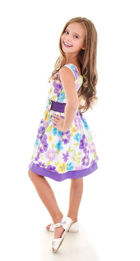 Uroczy uśmiechnięty małej dziewczynki dziecko w princess sukni odizolowywającej obrazy royalty free