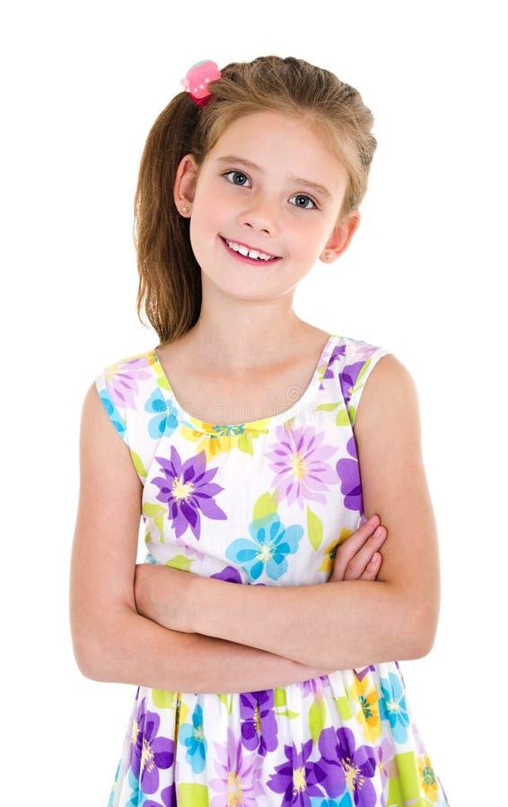 Uroczy uśmiechnięty małej dziewczynki dziecko w sukni odizolowywającej fotografia stock