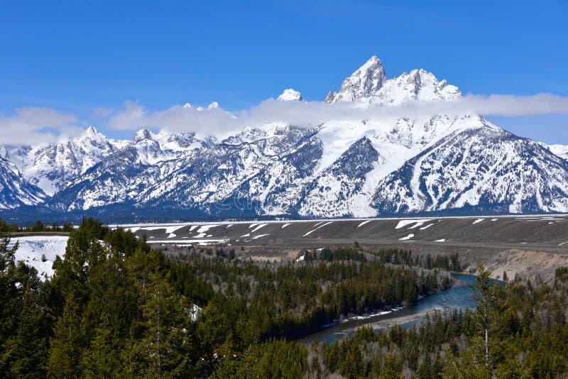 Uroczysty Teton park narodowy w wiośnie z śniegiem zakrywał teton pasmo górskie obrazy royalty free