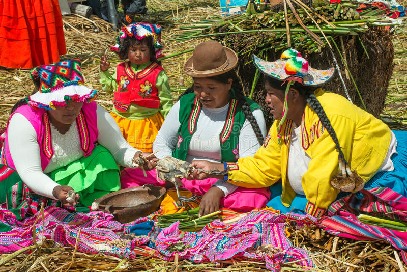 Uros People, Floating Island, Peru. Uros people who live on the floating islands of Lake Titicaca in Peru. Latin or South American and the Peruvian experience is