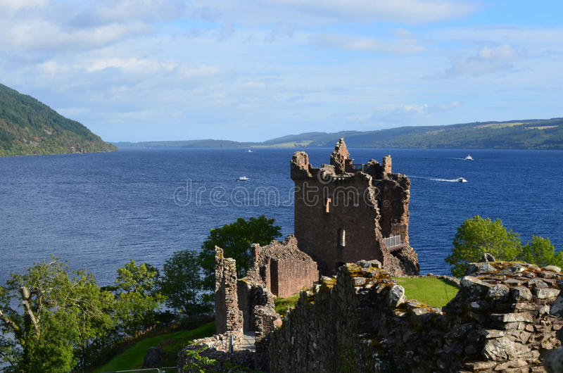 Urquhart Castle Stone Ruins and Loch Ness in Scottish Highlands. Loch Ness and Urquhart Castle ruins in the Scottish Highlands stock images