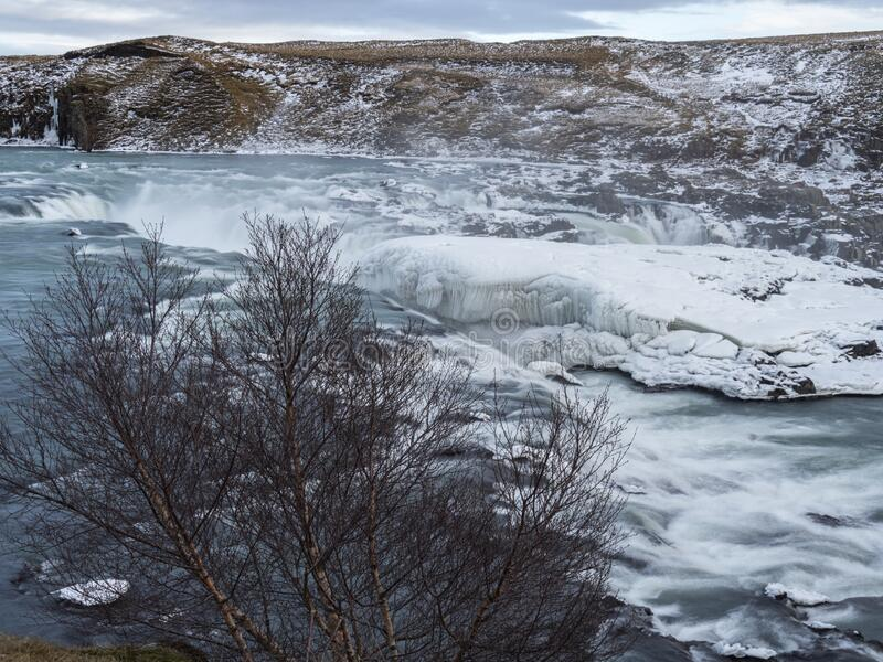 Urriðafoss in Iceland in icy bonds. The cold water flows between cliffs stock photo