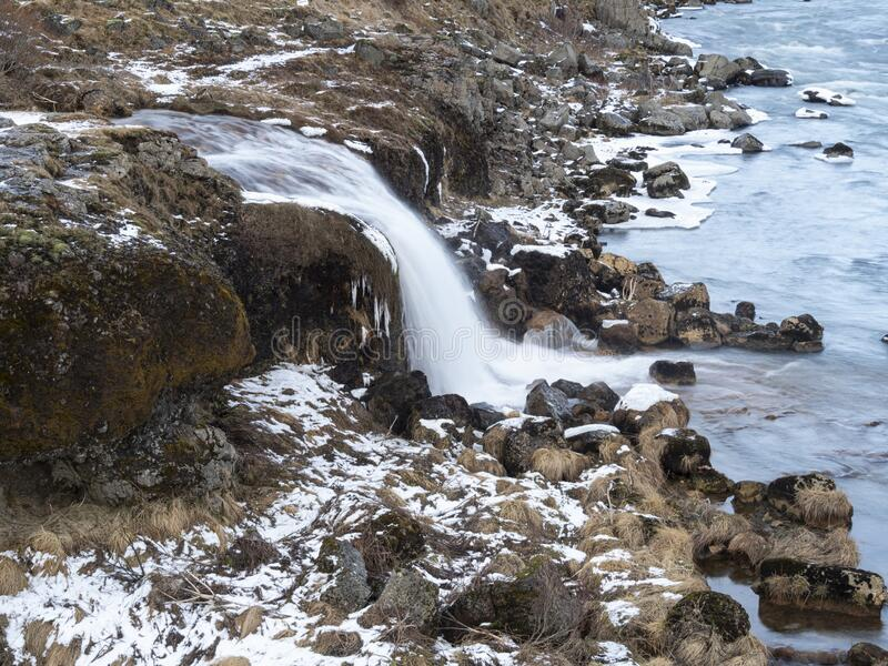 Urriðafoss in Iceland in icy bonds. Water stream in the river royalty free stock photo