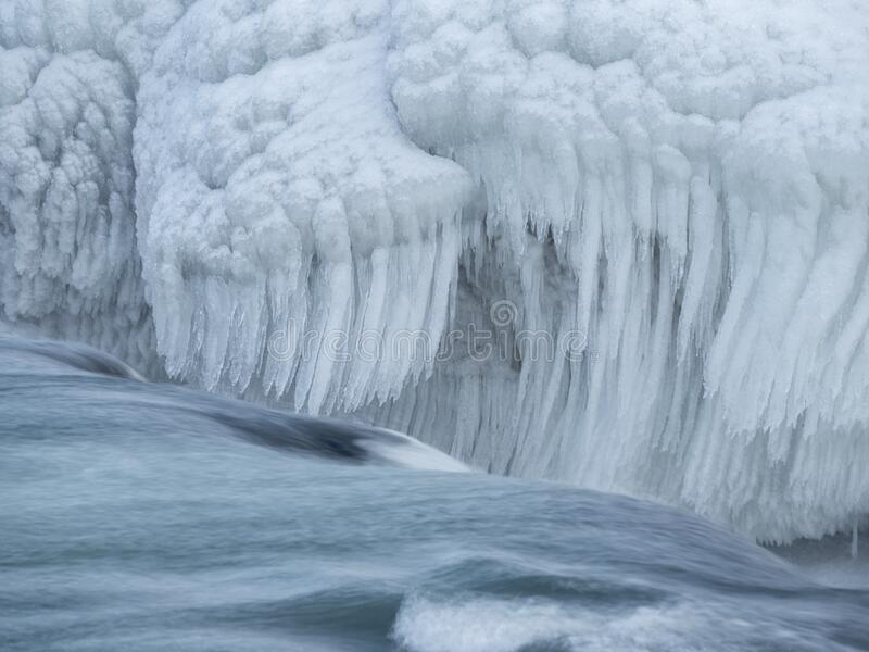 Urriðafoss in Iceland in icy bonds. Water stream in the river stock photos