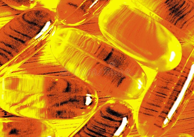 Ursnygga guld- kapslar för olja för torsklever exponerade av solljus arkivfoton