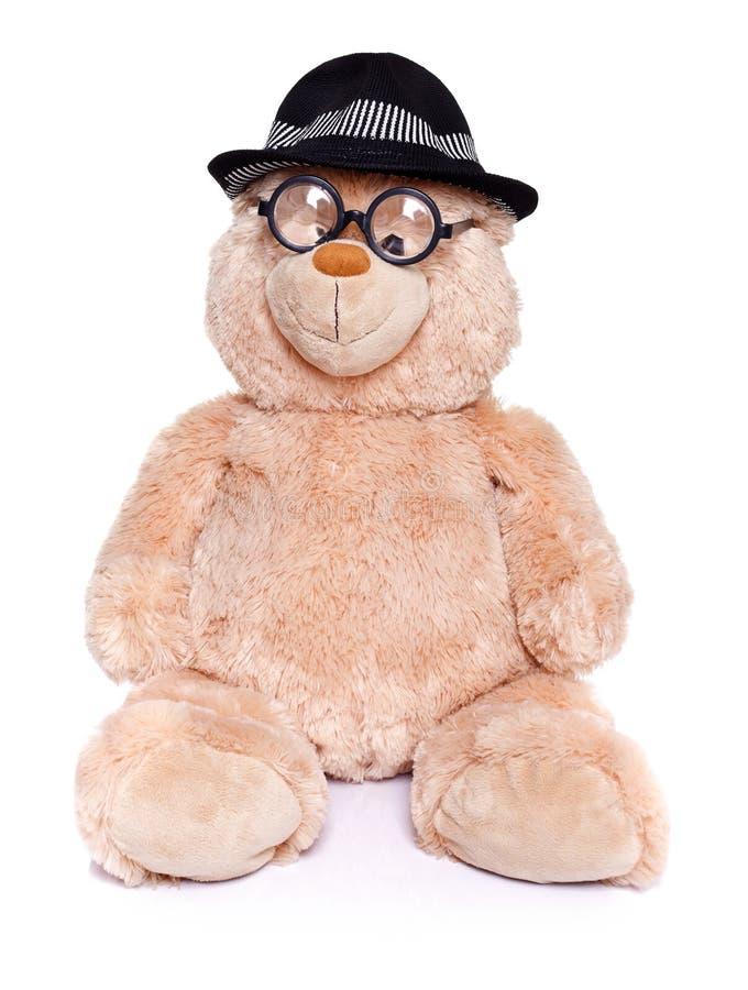 Urso da peluche com vidros e chapéu foto de stock