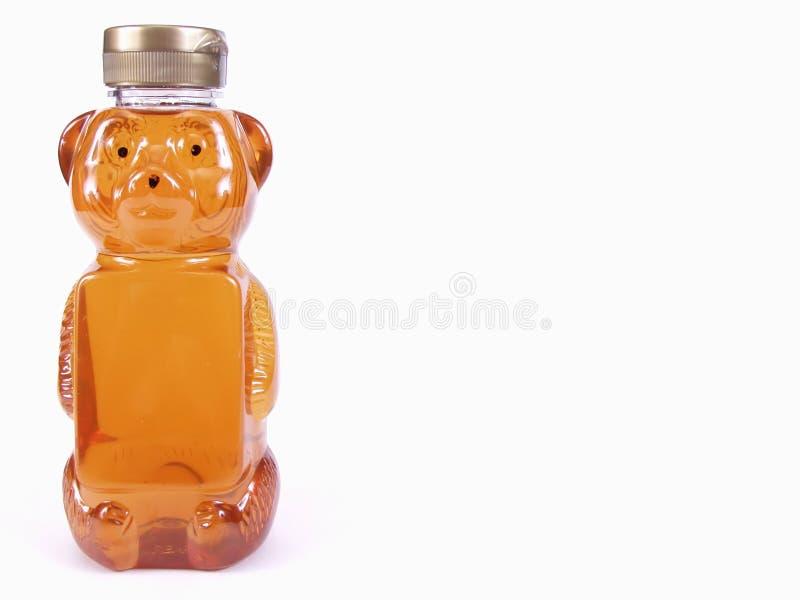 Urso de mel dourado, cheio, texto fotos de stock