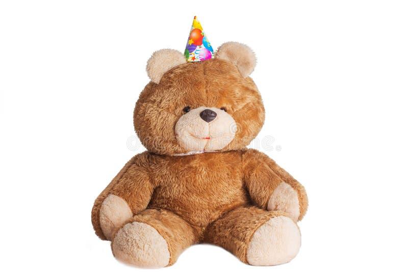 Urso de peluche clássico pronto para a festa de anos isolada no fundo branco fotografia de stock royalty free