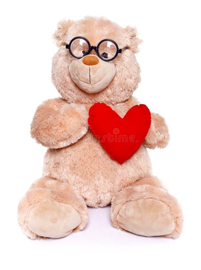 Urso de peluche esperto com coração vermelho foto de stock