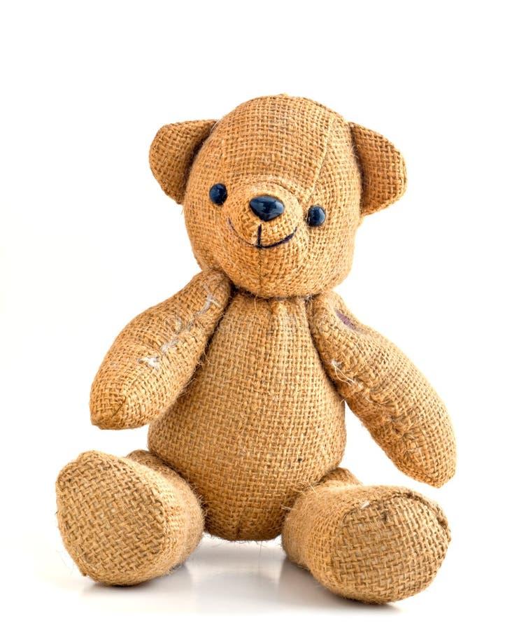 Urso de sorriso velho da peluche de serapilheira fotografia de stock royalty free
