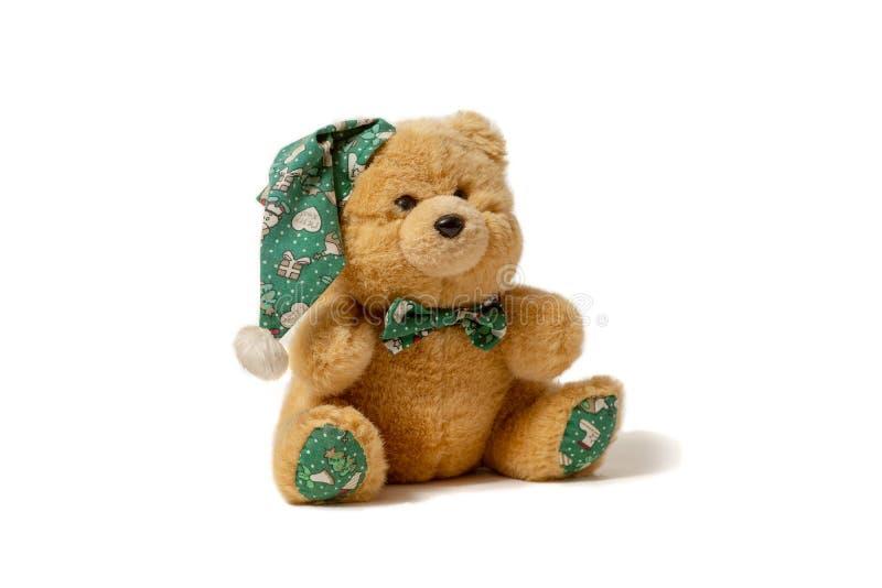 Urso do brinquedo no chap?u no fundo branco fotografia de stock royalty free