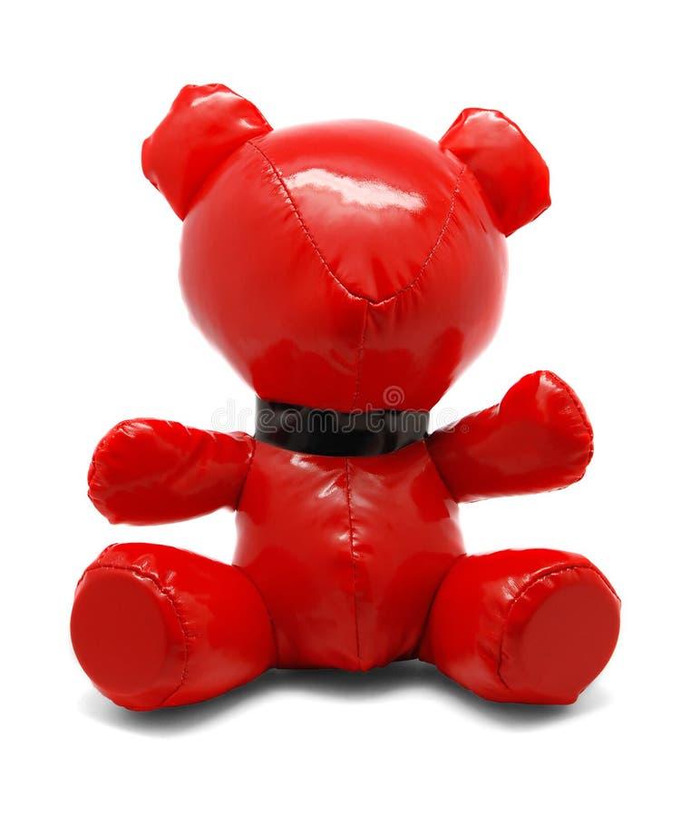 Urso vermelho do brinquedo do látex isolado no fundo branco imagens de stock