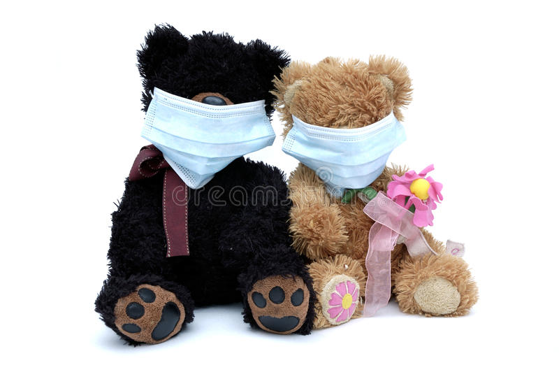 Ursos da peluche nas máscaras fotografia de stock