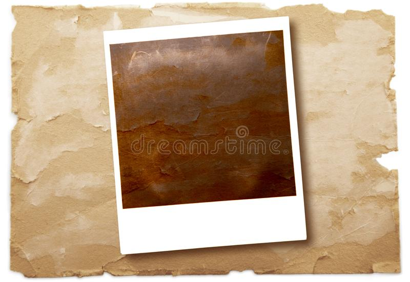 Ursprüngliches Polaroid auf Weinlesepapierhintergrund stockfoto