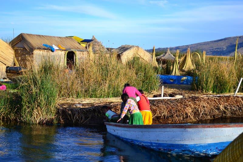 Uru people from floating Islands, lake Titicaca, Peru royalty free stock photo