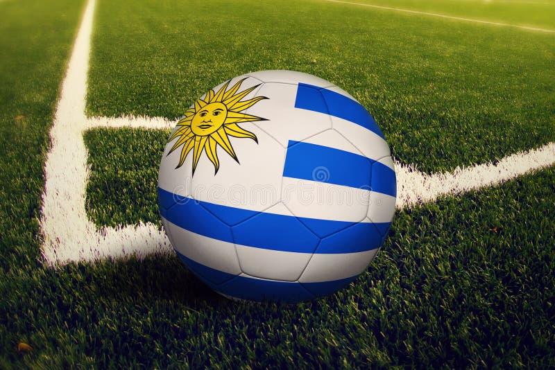 Uruguay ball on corner kick position, soccer field background. National football theme on green grass royalty free illustration