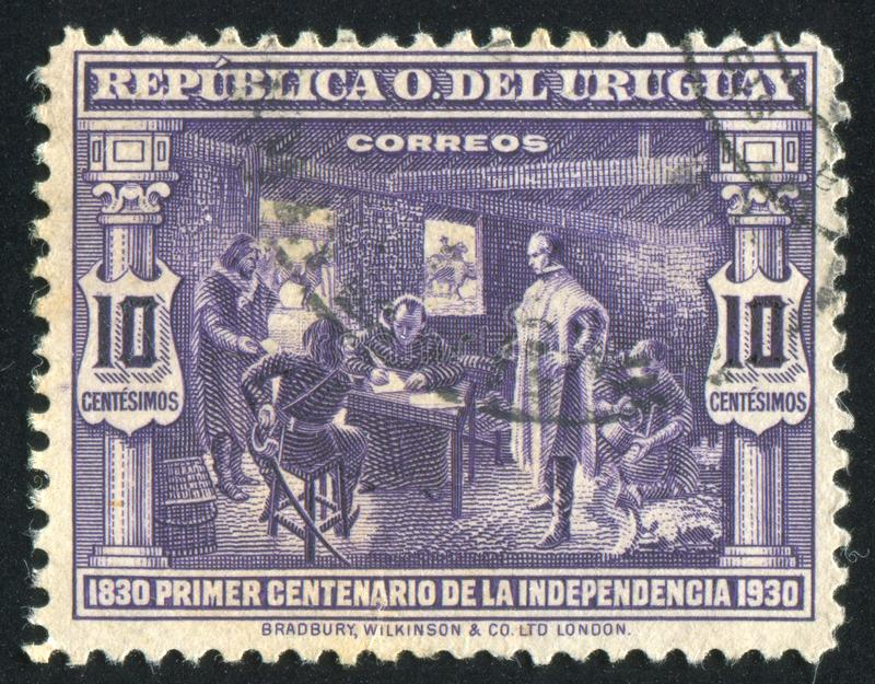 Artigas. URUGUAY - CIRCA 1930: stamp printed by Uruguay, shows Artigas Dictating Instructions for 1813 Congress, circa 1930 stock photo