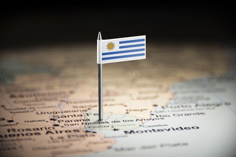 Uruguay markerade med en flagga på översikten arkivfoton