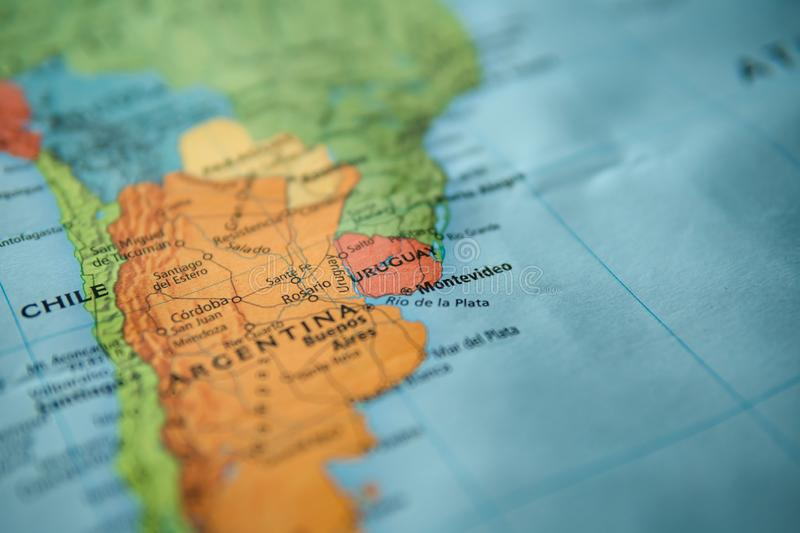 Uruguay and Montevideo on a map. Selective focus on label. Closeup shot royalty free stock photography