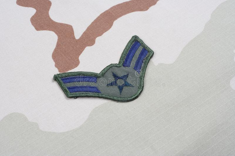 US AIR FORCE Airman First Class rank patch on desert uniform. Background stock image