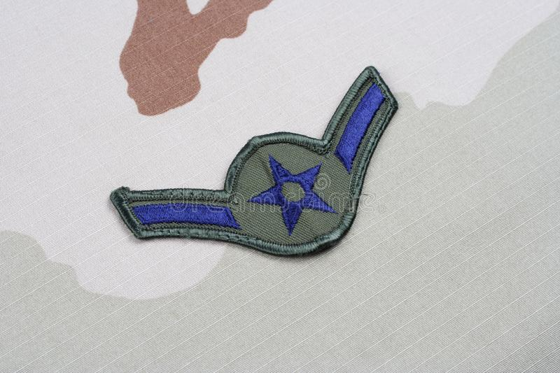 US AIR FORCE Airman rank patch on desert uniform. Background royalty free stock photo