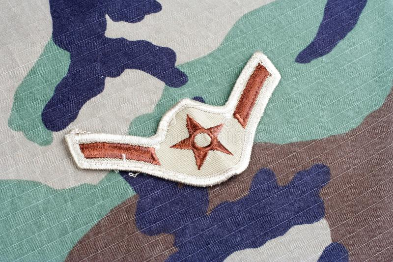 US AIR FORCE Airman rank patch on woodland camouflage uniform. Background royalty free stock photography
