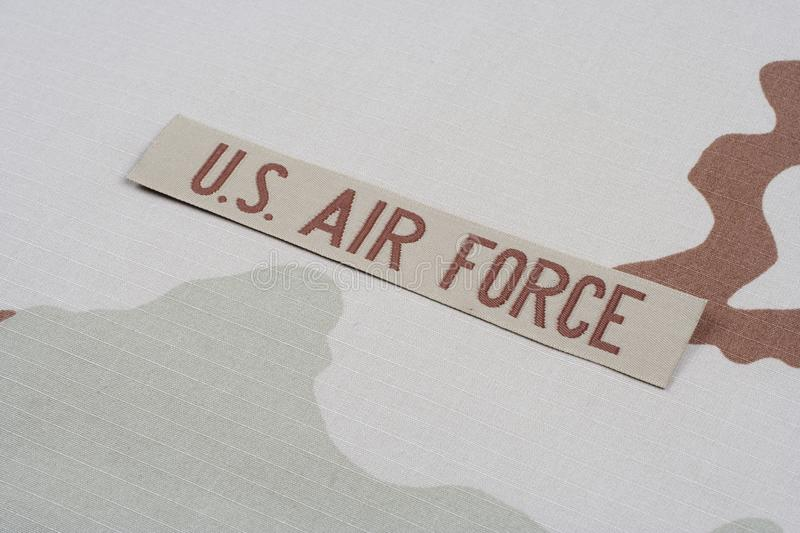 US AIR FORCE branch tape on desert camouflage uniform. Background stock image