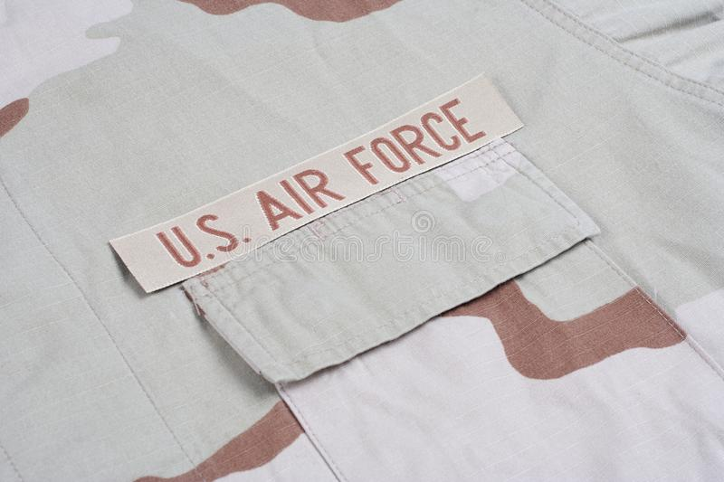 US AIR FORCE branch tape on desert camouflage uniform. Background royalty free stock photography