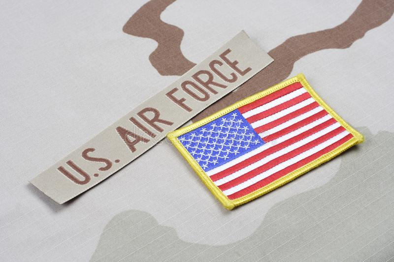 US AIR FORCE branch tape and US flag patch on desert camouflage uniform. Background royalty free stock photography