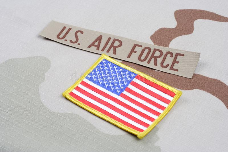 US AIR FORCE branch tape and US flag patch on desert camouflage uniform. Background royalty free stock photo