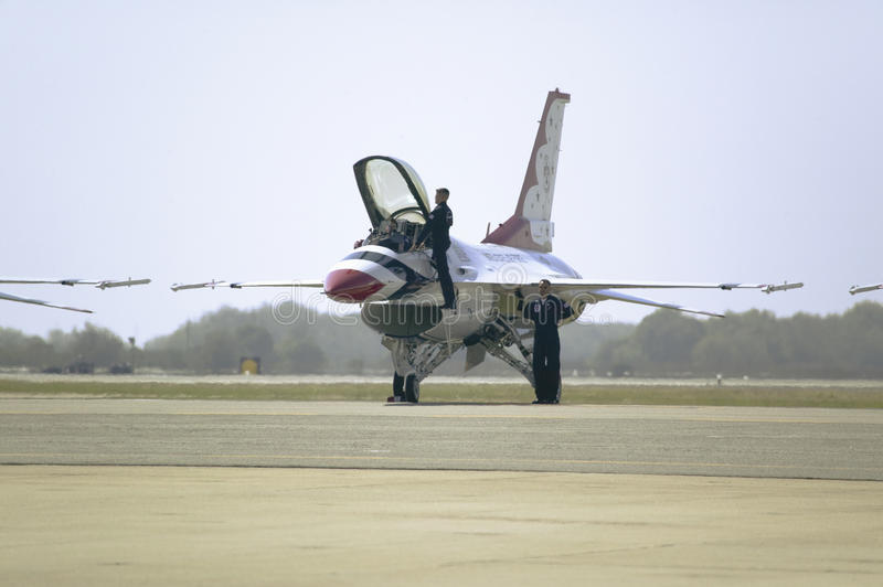 US Air Force pilot climbing into F-16C Fighting Falcons. Known as the Thunderbirds before flying at the 42nd Naval Base Ventura County (NBVC) Air Show at Point stock photography
