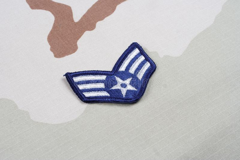 US AIR FORCE Senior Airman rank patch on desert uniform. Background royalty free stock photography