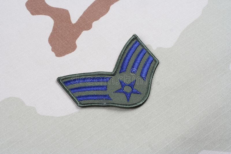 US AIR FORCE Senior Airman rank patch on desert uniform. Background royalty free stock photo