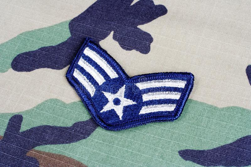 US AIR FORCE Senior Airman rank patch on woodland camouflage uniform. Background stock images